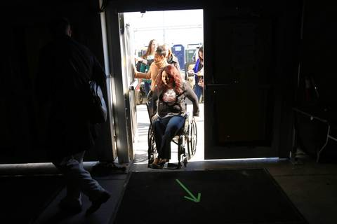 U.S. Rep. Tammy Duckworth makes her way backstage on Jan. 19, 2013, before speaking at a service summit on the National Mall in Washington during the National Day of Service, one of President Barack Obama's inauguration events.