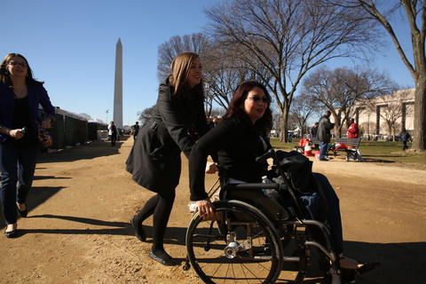 U.S. Rep. Tammy Duckworth, right, leaves the National Mall on Jan. 19, 2013, after speaking at a service summit in Washington during the National Day of Service.