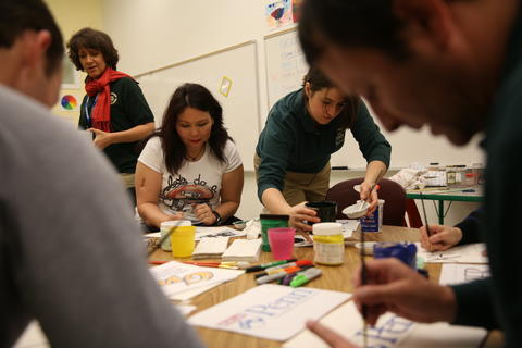 U.S. Rep. Tammy Duckworth, third from left, volunteers as part of the National Day of Service on Jan. 19, 2013, finishing college banners at Ideal Academy Public Charter School in Washington, D.C.