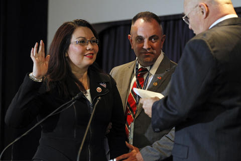 Rep. Tammy Duckworth, joined by husband Bryan Bowlsbey, participates in a ceremonial swearing-in on Jan. 3, 2013, at the Disabled American Veterans Headquarters.