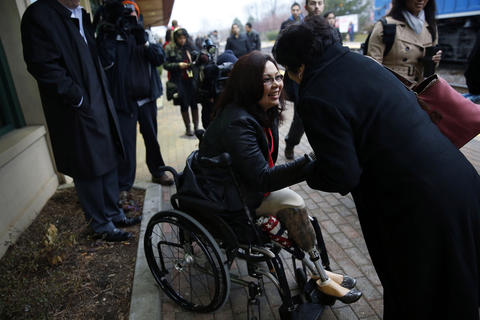 U.S. Rep.-elect Tammy Duckworth of the 8th Congressional District thanks voters and commuters at the Schaumburg train station on Nov. 7, 2012.