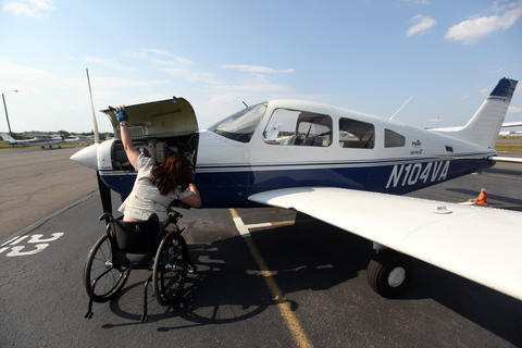 Tammy Duckworth does a pre-flight check of her aircraft at Manassas Regional Airport in Bristol, Va. on Aug. 23, 2009, where she is taking lessons to get a fixed-wing license.