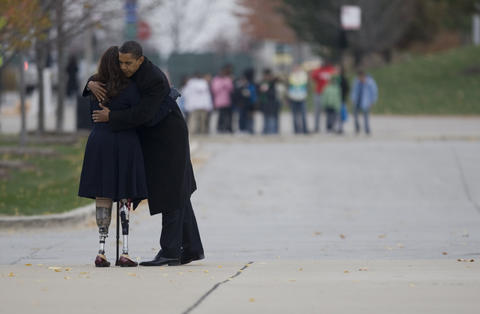 President-elect Barack Obama hugs Illinois Department of Veterans' Affairs Director Tammy Duckworth after laying a wreath at the Bronze Soldier Memorial near Soldier Field in Chicago on Nov. 11, 2008.