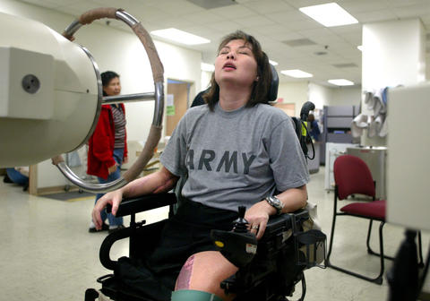 Tammy Duckworth rests in her wheel chair between rehabilitation exercises at Walter Reed Medical Center in Washington, D.C. on June 26, 2005. Duckworth is learning to walk with prosthetic legs and building strength in her injured right arm.