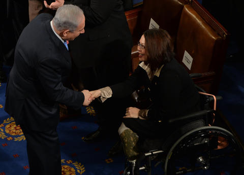 Israeli Prime Minister Benjamin Netanyahu greets Rep. Tammy Duckworth, D-Ill., before he addresses a joint meeting of Congress in Washington on March 3, 2015.