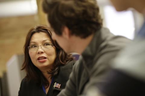 U.S. Rep. Tammy Duckworth meets with campaign volunteers and staff at her Elgin headquarters on Election Day on Nov. 4, 2014.