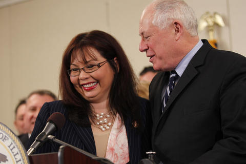 U.S. Rep. Tammy Duckworth, left, is introduced by Gov. Pat Quinn at a news conference Feb. 7, 2014, at St. Alexius Medical Center in Hoffman Estates.