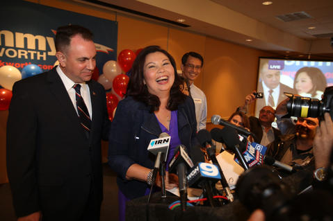 U.S. Rep.-elect Tammy Duckworth and her husband, Bryan Bowlsbey, soak up her victory over freshman Republican Rep. Joe Walsh at her post-election party in Elk Grove Village, Ill. on Nov. 6, 2012.