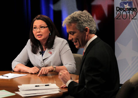 Democrat challenger Tammy Duckworth, left, and Republican Congressman Joe Walsh debate each other on May 11, 2012, at the CLTV studio in Chicago.