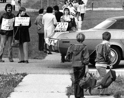 Oct. 17, 1975: Nathan Hale School students watch their teachers on the picket line. Despite the strike, the school remained open.