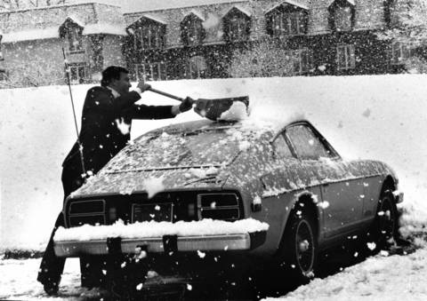 Nov. 27, 1979: A man sweeps his car in Schaumburg during a heavy snowfall.