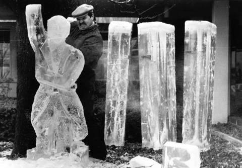 Feb. 8, 1986: James Nadeau works on a figure of Chicago Symphony Orchestra conductor Sir George Solti during the Greater Woodfield Winter Carnival's $5,000 Grand Prix de Ice Sculpture contest.