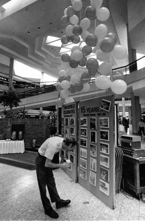 Oct. 14, 1986: A shopper looks at a display marking Woodfield Mall's 15th year.