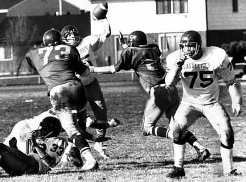 Schaumburg's Ken Jaffke (73) and Jeff Boji (85) close in on East Leyden's quarterback Larry Katzbeck (15) during a playoff game on Nov. 6, 1974. East Leyden won the game 14-8.