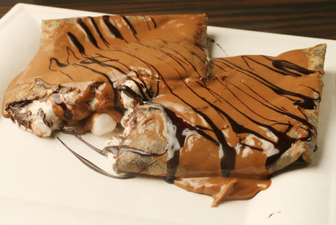 The crepe to try at Nu Crepesis the $5.50 Campfire. A swirl of melted marshmallows and semi-sweet chocolate oozes from the gargantuan treat. (115 W. Schiller Court, 630-577-7558)- Jessica Reynolds