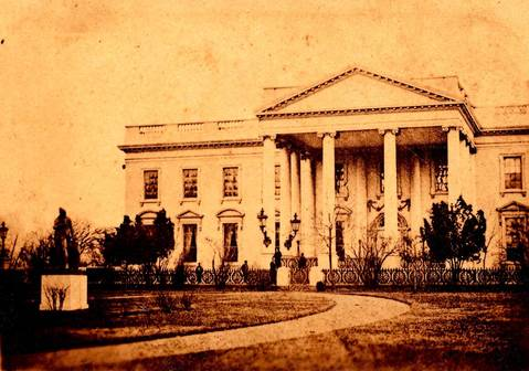 This March 6, 1865, photo, provided by the Keya Morgan collection/Lincoln Images and carrying the seal of photographer Henry F. Warren, shows the White House with several figures standing in front of it. Photography collector Morgan says the photo is the only known photograph of Lincoln standing in front of the White House, and the first photo ever to have been taken of a president in front of the White House.