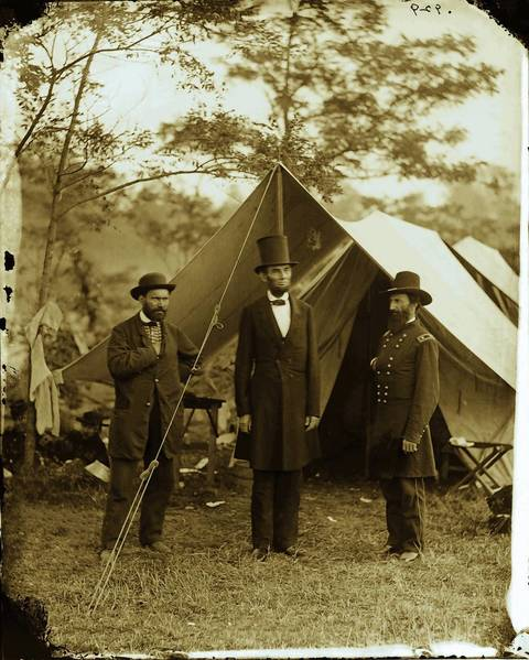 President Abraham Lincoln visits an Army camp during the Civil War.
