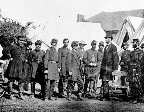 President Abraham Lincoln, wearing a top hat, visits with Gen. George McClellan and his staff at Antietam, Md., in 1862. This unique photograph, from the files of the Lincoln National Life Foundation in Fort Wayne, Ind., was taken by Alexander Gardner, a famous Civil War photographer.