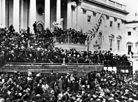 Abraham Lincoln speaks at his first inauguration March 4, 1861, at the Capitol, which was still under construction, in Washington.