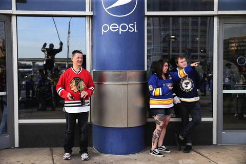 A Blackhawks fans and two Blues fans hang out at Scottrade Center in St. Louis before Game 1.