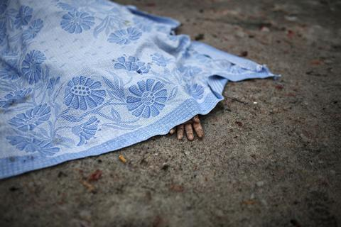 A body of a civilian killed in shelling is covered by a blanket in Donetsk, eastern Ukraine.
