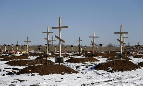 Unmarked graves are seen at a cemetery in the east Ukrainian village of Mospino, near the city of Donetsk, Ukraine.