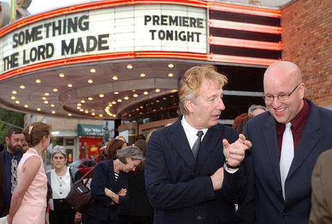 "Alan Rickman, left, star of HBO's ""Something the Lord Made,"" chats with the movie's executive producer Eric Hetzel before its premiere at the Senator Theatre."
