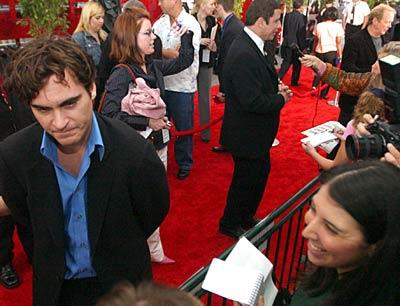 """Ladder 49"" star Joaquin Phoenix walks the red carpet before the movie's premiere at the Senator Theatre."