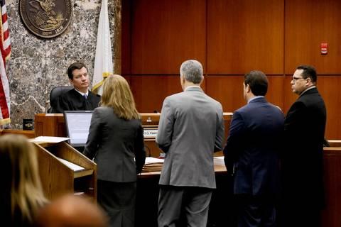 DuPage Circuit Judge Robert Kleeman, left, presides over the arraignment of Renato Velasquez, far right, March 3, 2014.