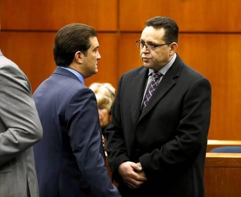 Renato Velasquez, right, listens to his attorney, Steven Goldman, during his arraignment March 3, 2014.