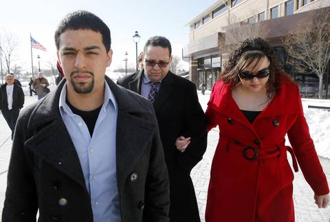 Truck driver Renato Velasquez, center rear, leaves the DuPage County Courthouse in Wheaton on March 3, 2014, after pleading not guilty to felony driving safety violations charges.