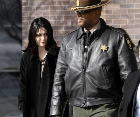 Illinois State police Capt. Patrick Kimes escorts Kim Balder, wife of Trooper Douglas Balder, from court March 3, 2014. Renato Velasquez pleaded not guilty to felony driving violations stemming from the Jan. 27 crash that killed Vincent Petrella and injured Douglas Balder.
