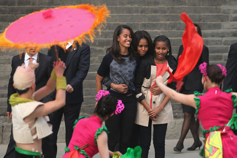 First lady Michelle Obama and daughters Malia, left, and Sasha visit the Xi'an City Wall in Xi'an, China, on March 24, 2014.