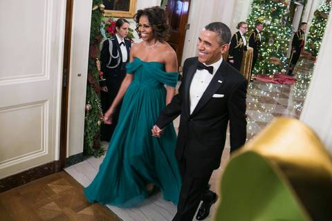 President Barack Obama and first lady Michelle Obama arrive for a reception at the White House for the 2013 Kennedy Center honorees.
