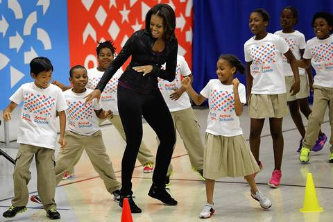 """Michelle Obama exercises with schoolchildren Sept. 6, 2013, at Orr Elementary School in Washington, D.C., as part of a """"Let's Move! Active Schools"""" event."""