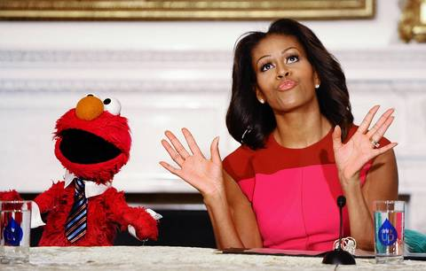 """Michelle Obama is joined by Elmo from """"Sesame Street"""" on Oct. 30, 2013, to talk healthy food and to harvest the White House garden"""