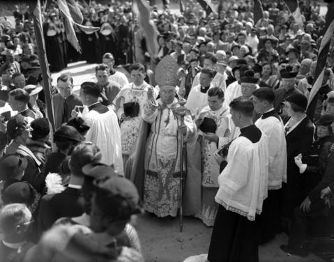 Cardinal George Mundelein, center, at a church in Mundelein, Ill., in 1935.