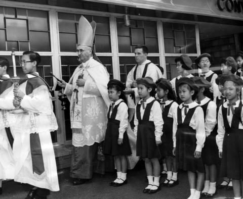 Cardinal Albert Meyer dedicates St. Therese Chinese Catholic School on April 30, 1961, surrounded by students in Chicago's Chinatown.