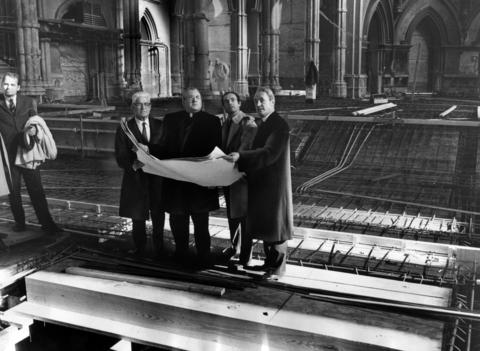 Thomas Henry, general contractor, from left, Cardinal John Cody, C.F. Murphy Jr., architect, and the Rev. Timothy J. Lyne, rector, view blueprints from the $2 million reconstruction project of Holy Name Cathedral on Nov. 26, 1968. The work was expected to be finished the following year.