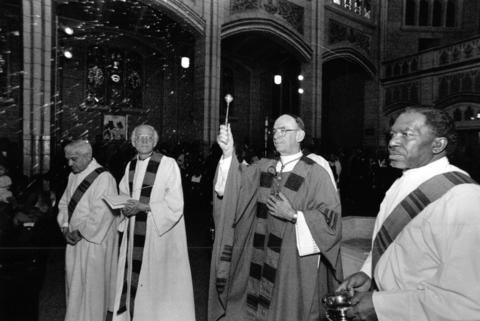 Cardinal Joseph Bernardin, second from right, dedicates the St. Martin de Porres Church on Feb. 9, 1992, at 5112 W. Washington Blvd. after it was completely restored.