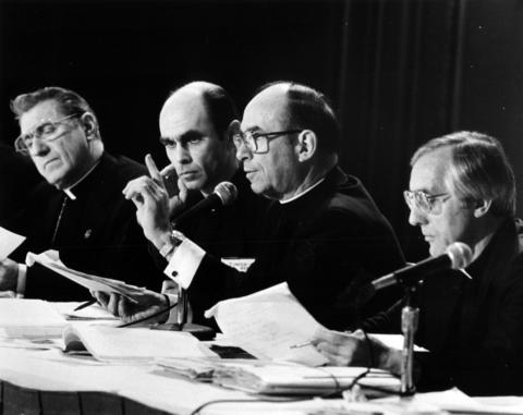 Cardinal Joseph Bernardin, second from right, discusses a resolution on nuclear disarmament May 3, 1983, at the National Conference of Catholic Bishops at the Palmer House Hotel in Chicago.