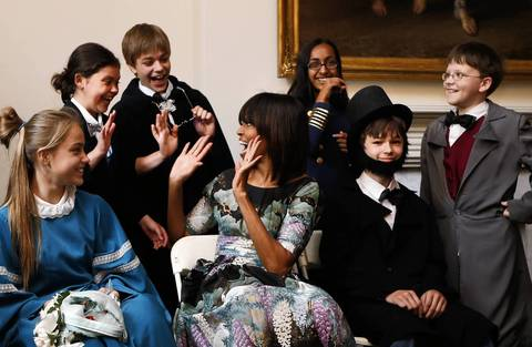 Michelle Obama talks to schoolchildren from Willow Springs Elementary School in Fairfax, Va., on May 22, 2013, as they participate in a play about the emancipation of slaves during Abraham Lincoln's presidency, at historic Decatur House in Washington, D.C.