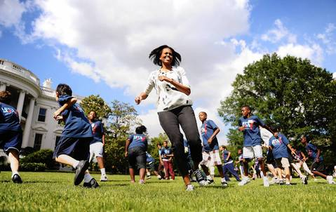Michelle Obama works out with Washington, D.C.-area students on the South Lawn of the White House on May 25, 2010, as she kicks off the first in a series of summer activities for kids.