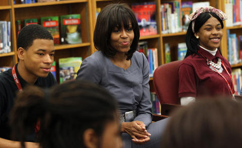 First lady Michelle Obama visits Harper High School in Chicago on April 10, 2013, to hear how violence touches students' lives.