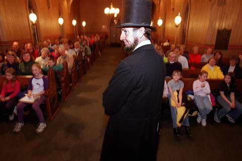 Feb. 2, 2001: An Abraham Lincoln performer entertains a group of kids at Naper Settlement.
