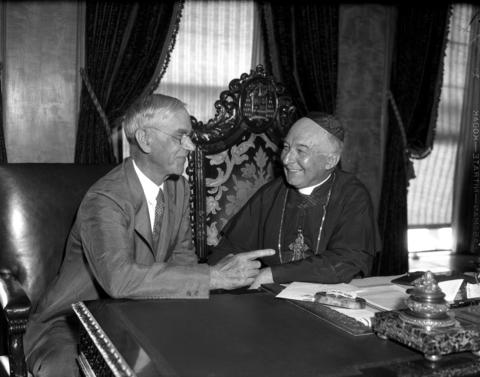 Sen. Reed Smoot of Utah, left, talks with Cardinal George Mundelein on Aug. 18, 1932, in Chicago. Smoot, a Mormon, was in town to discuss welfare for the youth. According to the Tribune, Smoot was impressed with Mundelein's work with the Chicago Catholic Youth Organization.