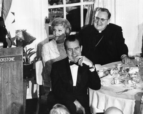 President-elect Richard M. Nixon, his wife Pat and Cardinal John Cody listen to Gov.-elect Richard Ogilvie at a dinner at the Sheraton-Blackstone Hotel on Jan. 3, 1969, in honor of three Chicagoans who would join the Nixon administration.