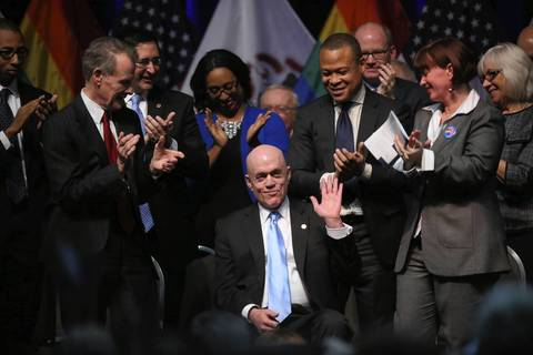 Illinois Rep. Greg Harris (D-Chicago) waves to the crowd before Governor Pat Quinn signs a bill legalizing gay marriage, at the UIC Forum. The signing makes Illinois the 16th state to legalize gay marriage.