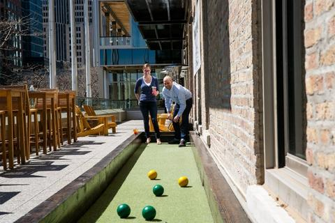 Play a round of bocce ball on the patio of Pinstripes in Streeterville.
