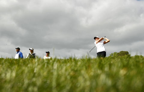Stacy Lewis, right, drives the ball off the tee of the 13th hole during Saturday's third round of the LPGA Kingsmill Championship.